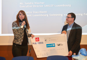 FLNS President Marco Stacchiotti presents a check to UNICEF's Sandra Visscher (Photo courtesy FLNS)