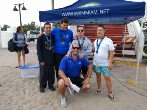 Director Jonathan Strauss with several Special Olympics finishers