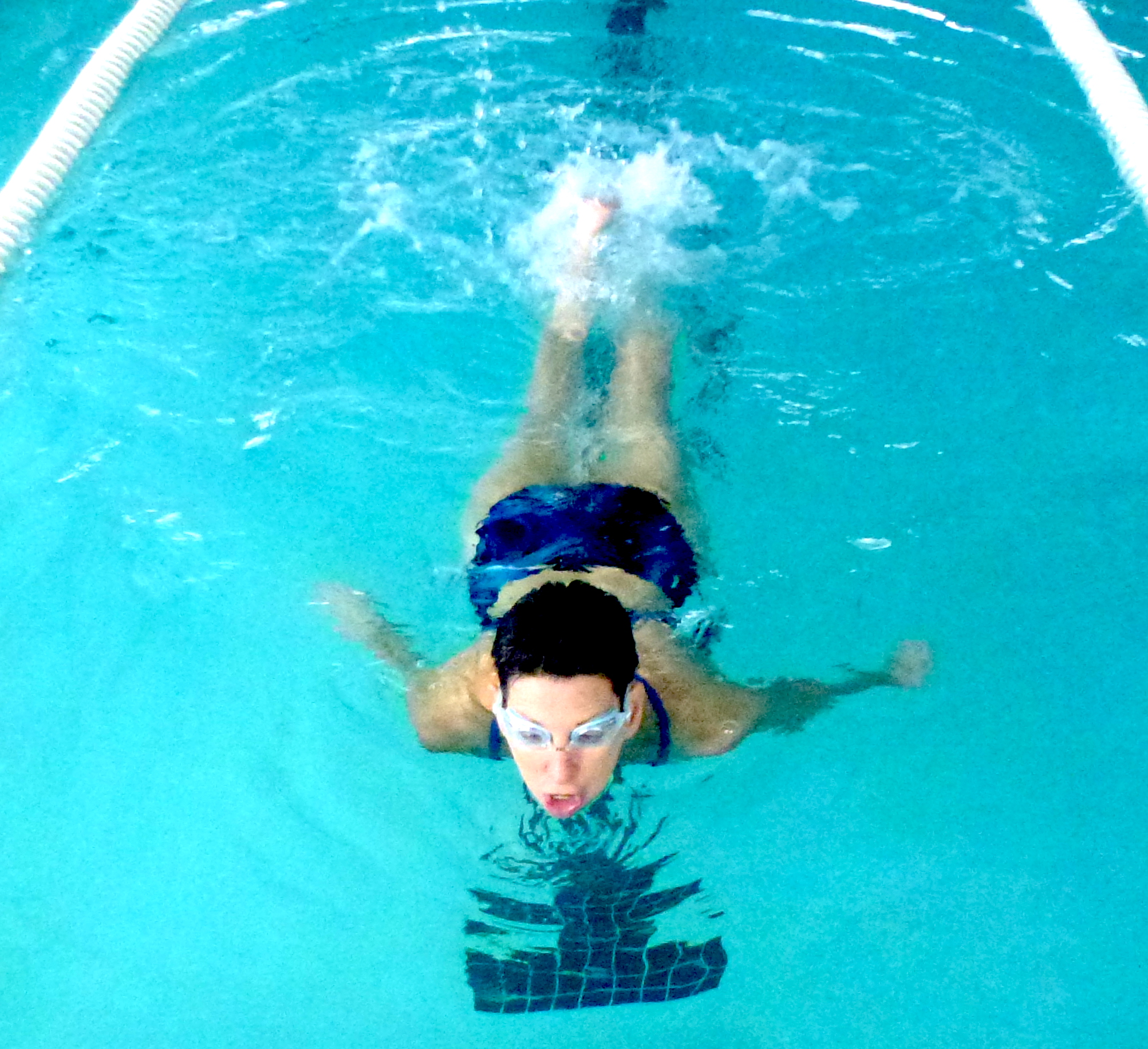 Swimming laps involves kicking only from the knee not from the hips Swimming laps involves kicking only from the knee not from the hips new picture